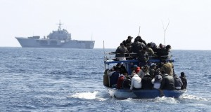 People fleeing the unrest in Tunisia transfer onto the Italian military ship San Marco, off the southern Italian island of Lampedusa March 23, 2011. The San Marco arrived on Wednesday and will accommodate some 1,000 immigrants who have arrived in Lampedusa from Tunisia.  REUTERS/Alessandro Bianchi  (ITALY - Tags: POLITICS CIVIL UNREST MILITARY SOCIETY)