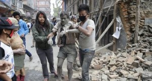 epaselect epa04719891 People free a man from the rubble of a destroyed building after an earthquake hit Nepal, in Kathmandu, Nepal, 25 April 2015. A 7.9-magnitude earthquake rocked Nepal destroying buildings in Kathmandu and surrounding areas, with unconfirmed rumours of casualties. The epicentre was 80 kilometres north-west of Kathmandu, United States Geological Survey. Strong tremors were also felt in large areas of northern and eastern India and Bangladesh.  EPA/NARENDRA SHRESTHA