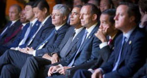 U.S. President Barack Obama, center, is seated with other world leaders as they watch a cultural performance of indigenous dancers at the G20 Summit in Brisbane, Australia, Saturday, Nov. 15, 2014. Also seated are from left to right., Russian President Vldamir Putin, South African President Jacob Zuma, Italian Prime Minister Matteo Renzi, Chinese President Xi Jinping, Canadian Prime Minister Stephen Harper, Austrian Prime Minister Tony Abbott,  Indonesian President Joko Widodo, and British Prime Minister David Cameron. (AP Photo/Pablo Martinez Monsivais)