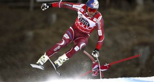 Aksel Lund Svindal speeds down the course on his way to win an alpine ski, men's World Cup super-G, in Val Gardena, Italy, Friday, Dec. 18, 2015. (AP Photo/Shinichiro Tanaka)