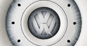 A Volkswagen (VW) logo covered with mud and dust is seen on the wheel of a car in Grafenwoehr, Germany, October 26, 2016.   REUTERS/Michaela Rehle/File Photo