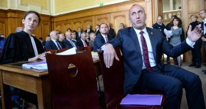 Former Kosovo prime minister Ramush Haradinaj (R) sits next ot his lawyer  Rachel Lindon (L) as he waits in the courthouse of Colmar, eastern france, on March 6, 2017, during the appeal court proceedings on his extradition case. Haradinaj was arrested in France in January 2017 under an international warrant issued by Serbia, which wants him tried for alleged war crimes committed during the 1999 conflict.  / AFP PHOTO / Sebastien Bozon