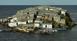 Migingo Island is an island completely covered in tiny shacks. The first shacks were only built in 2002, but today, between 100 and 200 people live on the small island, which is only the size of half a football pitch. The population density of this tiny, crowded island is approximately 250,000 per square mile. Both Kenya and Uganda lay claim to the crowded island. (CARL DE SOUZA/AFP/Getty Images)