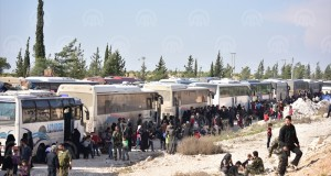 ALEPPO, SYRIA - APRIL 14: Syrian people from the city of Douma arrive in Al-Bab district of Aleppo, Syria on April 14, 2018. The 20th 85-bus convoy carrying civilians and opposition fighters from the city of Douma in the Damascus suburb of Eastern Ghouta arrived in Aleppo's Al-Bab district. Turkey's Operation Euphrates Shield, launched in late 2016, liberated Al-Bab from the Daesh terrorist group. Home to 400,000 residents, Eastern Ghouta has remained under a crippling regime siege for the last five years, which has prevented the delivery of badly needed humanitarian supplies. ( Anadolu Agency - Hüseyin Nasır )