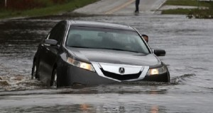 LELAND, NC - SEPTEMBER 16: A motorist successfully navigates a flooded road on September 16, 2018 in Leland, North Carolina. Hurricane Florence hit area as a category 1 storm causing widespread damage and flooding across North Carolina.   Mark Wilson/Getty Images/AFP