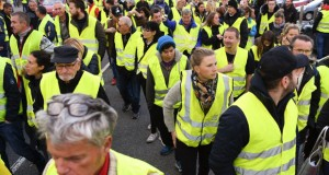 Demonstrator wearing Yellow Vests (Gilets jaunes) protest against the rising of the fuel and oil prices on November 17, 2018on the RN 90 road between Albertville and Chambery, central eastern France. - French drivers seething over high fuel prices have vowed to snarl traffic across the country on November 17 in a widely supported protest that could prove the trickiest so far for French President. (Photo by JEAN-PIERRE CLATOT / AFP)
