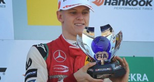 Mick Schumacher holds his trophy after winning the FIA Formula Three European Championship at the Hockenheim race track in Hockenheim, western Germany, on October 14, 2018. - His first F3 title means Mick Schumacher has qualified for a FIA 'super licence', a prerequisite for the jump to Formula One, and follows on from his father Michael Schumacher, who won the German F3 championships 28 years ago. (Photo by Daniel ROLAND / AFP)