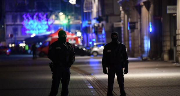 epa07224950 French police officers stand guard at an emergency services makeshift base after a deadly shooting in Strasbourg, France, early 12 December 2018. According to the latest reports, four people were killed. According to reports, four people have been killed and more than 10 people have been injured after a deadly attack at the Christmas market in Strasbourg. The gunman is reported to be at large and the motive for the attack is still unclear.  EPA-EFE/PATRICK SEEGER